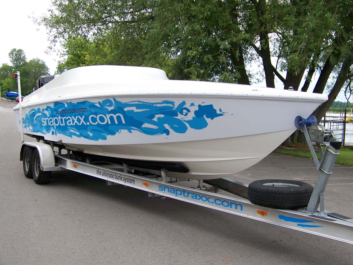Image of boat already on trailer fitted with Snaptraxx bunk system, clearly allowing the air to circulate beneath the boat hull to air dry